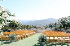 Like the simple floral decor at the head of the aisle & the altar. Would like to add garland to back of the aisle.