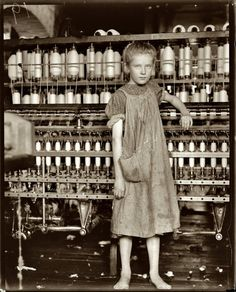 """February 1910. Addie Card, 12 years old, anemic little spinner in North Pownal Cotton Mill, Vermont. Girls in mill say she is ten years. She admitted to me she was twelve; that she started during school vacation and would """"stay."""" by Lewis Wickes Hine. """"It always amazes me to see kids working without shoes in factories where you would not dare to enter without workboots nowadays... how times change. I can't imagine not having shoes in a place like Vermont where it's warm only 3-4 months a yea..."""