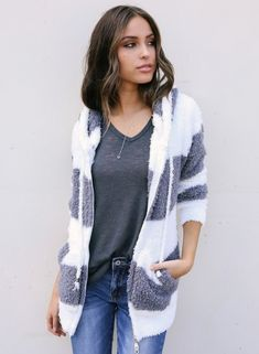 The white&grey color coat is featuring hood style, color block, zipper front.