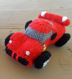Free Knitting Pattern for Sports Car Toy - Knit a Ferrari-style model of a sports/race car stuffed toy. When knitted with worsted weight yarn and US size 6 needles, it measures about 6 inches long, but the gauge is not important. Designed by Ilana Marks