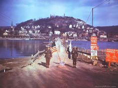 's stand in front of the heavy pontoon bridge Royalty Free Color Pictures of World War II. Military Police, Colorful Pictures, World War Two, Ww2, Germany, Street View, River, Colorized Photos, World War Ii