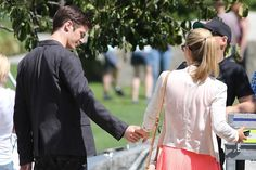 """The Flash"" shoots episode 4 in downtown Vancouver, Canada with an ""Arrow"" crossover where Grant Gustin and Emily Bett Rickards meet at a park where Grant ""The Flash"" Gustin tries to impress Emily's character Felicity Smoak and then taking her hand walking away into the sunset."
