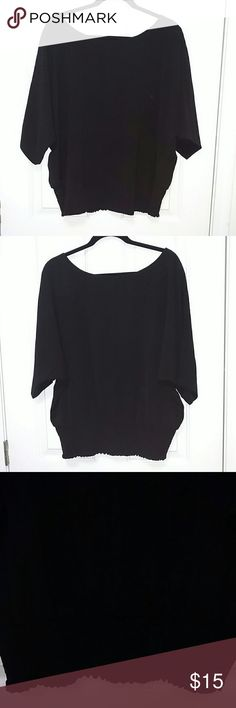 Black blouse Black blouse, sheer material, elbow length sleeves, scrunched band around the bottom of the back, gently used condition. New York & Company Tops