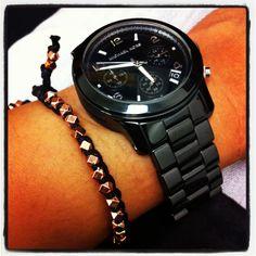 Michael Kors black ceramic watch and Shashi rose gold nugget bracelet.