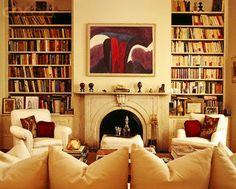 Bookshelves, fireplace, furniture arrangement