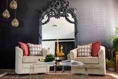 Vintage Eclectic Moroccan inspired living room   World Market Acrylic Coffee Table   World Market Persian Rug and curtains   Brass shelves   Black gaudy leaning mirror   Black living rooms   Moody decor