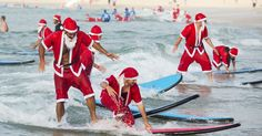 "A flock of Christmas enthusiasts — 320 to be exact — dressed up as Santa Claus and spent their day learning how to ride the waves at Sydney's Bondi Beach, setting a new Guinness World Record for ""the world's biggest surf lesson,"" which was previously held by 250 people.  People both young and old donned the red suit and beard combo, spreading Christmas cheer at the famous beach and raising money for One Wave, a non-profit surfing community that raises awareness for mental health issues."