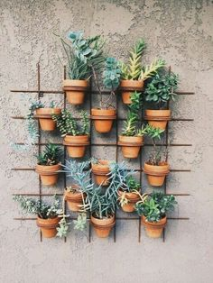 Hang pot plants down from outside stair railing or just place them next to the stair railings