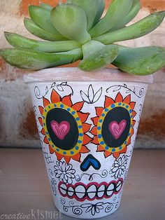 omg i love sugar skulls....   would be cool to do a pot for a cactus  or just a glass :)
