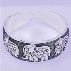 ELEPHANT CUFF BRACELET Pretty cuff bracelet. Adjustable. Silver tone. Second pic is the bracelet. No trades Jewelry Bracelets