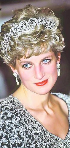 Princess Diana, wearing the Spencer Tiara. Love the dress, goes perfectly with the Tiara.