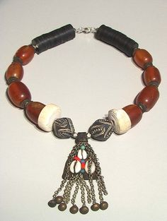Tuareg African amber shell and leather Kauri by tribalgallery, $210.00