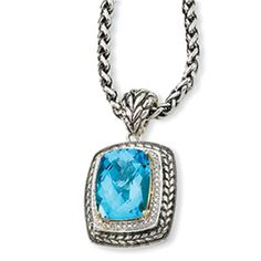 "14kt with Sterling Silver Vintage style Pendant with 13.50ct Swiss Blue Topaz surrounded with Diamonds. $399Includes 17"" Chain"