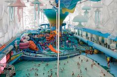 China, Beijing. A view into the Happy Water Park from the main water slide tower..Beijing Olympic aquatic centre, known as the Water Cube re-opened as Asia's largest indoor water park...