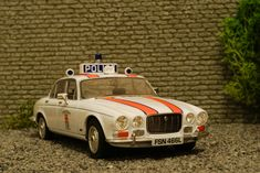 Dunbartonshire Police Jaguar XJ6 1:43 British Police Cars, Classic Race Cars, Van Car, Car Badges, Vintage Race Car, Emergency Vehicles, Top Cars, Rally Car, Model Trains