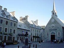 Canadá - Notre-Dame-des-Victoires en el histórico Basse-Ville de Quebec. La población quebequense es en su mayor parte francófona, con una minoría de población de habla inglesa.