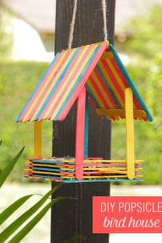 Popsicle stick art Embrace your inner Snow White and bring birds to your backyard with this adorable DIY Popsicle Bird House. Grab some colorful popsicles, hot glue, and start building! Let your little ones help you create this fun craft. Popsicle Crafts, Craft Stick Crafts, Fun Crafts, Arts And Crafts, Craft Stick Projects, Craft Ideas, Popsicle House, Diy Projects, Decor Crafts