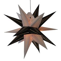 Moravian Black & white star lamps http://www.29june.com/index.php/paper-stars.html