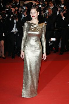 15 May Marion Cotillard made her first Cannes Film Festival appearance of 2016 in a shimmering golden gown.   - HarpersBAZAAR.co.uk