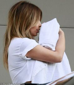A kiss for her little princess: Kim Kardashian showered her baby girl North West with love as they left the Hollywood Hills property