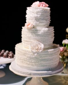 This ruffle-covered cake features three flavored tiers: red velvet, chocolate truffle, and banana