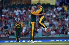 South Africa's paceman Kyle Abbott (C) celebrates his wicket with teammate Faf du Plessis during the 2015 Cricket World Cup Pool B match between ...