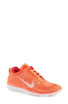 These lightweight and flexible Nike shoes are too cute! Loving the bright color.