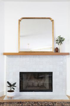 Design inspo: Cool fireplaces to keep you warm this winter - STYLE CURATOR Design inspo: Cool fireplaces to keep you warm this winter. White fireplace, white square glaze tile around fireplace, modern fireplace makeover, fireplace ideas Tile Around Fireplace, Fireplace Tile Surround, Brick Fireplace Makeover, White Fireplace, Fireplace Mantle, Fireplace Surrounds, Fireplace Design, Fireplace Ideas, Fireplace Modern