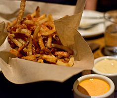 Diners come to this New American restaurant in search of Top Chef season 4 winner Stephanie Izard's pork- and seafood-heavy farm-to-table comfort food. Her Ham Frites are arguably some of the best in the country, made with homemade ham salt and served with smoked tomato aioli and cheddar beer sauce.