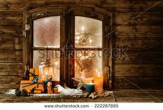 Festive Wooden Christmas Cabin Window With Gift-Wrapped Colorful Orange Presents, Burning Candles And Decorations In Winter Snow And A Glimpse Of A Decorated Christmas Tree Through The Frosted Window Stock Photo 222267895 : Shutterstock
