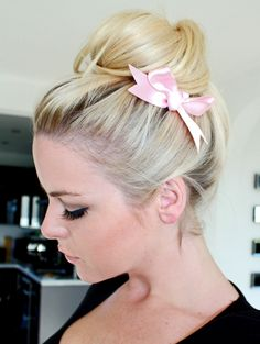 Did you wear ribbons in your hair as a little girl?  The trend is now even well suited for adults.  And really, it looks pretty chic.  It can be worn to hide the elastic of your ponytail or braid or as a headband. Or even wrap the ribbon around the base of a bun.  www.terrabacio.com