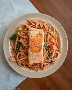 Salmon tagliatelle with homemade creamy sun dried tomato pesto pasta sauce || Love salmon? Get a taste of Italy with this salmon pasta with creamy sun-dried tomato pesto sauce! Learn how to make pan-seared salmon with creamy tomato pasta in 30 minutes. Check out this creamy pasta with salmon recipe on Travelling Foodie. #travellingfoodie #recipes #easyrecipes #pastarecipes #creamypasta Salmon Pasta Recipes, Creamy Salmon Pasta, Creamy Tomato Sauce, Tomato Cream Sauces, Tomato Pesto, Easy Pasta Recipes, Pasta Ideas, Pesto Pasta, Dinner Recipes