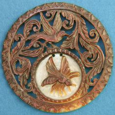 Antique carved & pierced mother-of-pearl button.