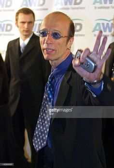 Robin Gibb the Bee Gees waves during a photocall following the World Awards ceremony in Hamburg 22 October 2003.