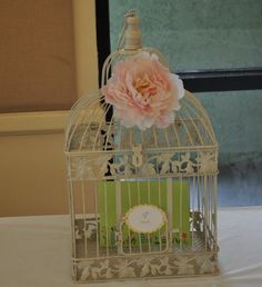 Card holder bird cage with flower peony for pink and yellow baby shower.
