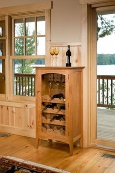 A fine furniture storage solution for your finest wines. Store and display 16 bottles of your favorite wine and 12 to 16 wine glasses in this beautiful hardwood cabinet. No need for wine glass storage? The top shelf easily converts to another bottle holdi