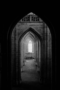 Browse Free HD Images of A Corridor Of Archways Leads To A Gothic Window