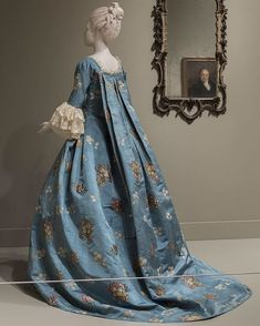 """This dress is believed to have been worn by Ann Willing Francis, wife of a prominent 18th century Philadelphia lawyer. It was altered several times over the years to reflect changing styles and occasions. Due to its delicate nature, it's only on view for a short time as part of """"The Cadwaladers of Philadelphia: Portraits of a Family."""" """"Woman's Dress (Open Robe à la française and Petticoat),"""" c. 1760–65 with later alterations, made in France and the United States"""