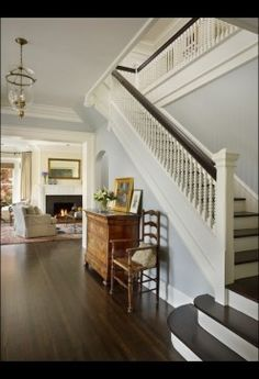 love!   1 toned wall. light gray wall  all white stairs and railing   clean dark line + dark steps.  but step+railing construction is different