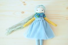 This is blue rag doll handmade cloth doll. Soft 10 linen toy. Toddler heirloom gift. Girl nursery decor. Dollhouse miniature. Interior decor.  She is perfect for story time and nap time buddy. Her hair is as bright as their personality! This sweet rag doll makes a great gift for any little girl! She is absolutely adorable, a perfect combination of sweetness and love. She is sure to become a loyal and fun loving companion.  ✿ Suitable for: children over 3 years old. ✿ Material: linen, muslin…