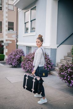 Gal Meets Glam Easy Travel Style - Rebecca Taylor sweater, The Lady & The Sailor tee, Frame Denim jeans, Steamline Luggage c/o and Celine bag