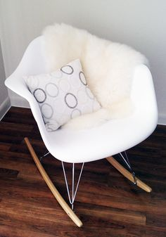 Eames rocker with sheepskin