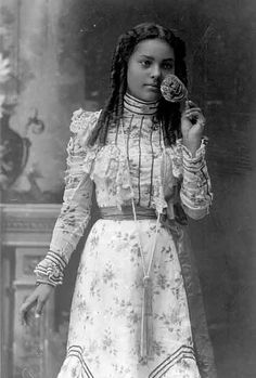 B  photo of a young African American girl from 19th Century in a pretty dress. Lovely