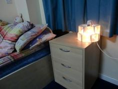 """""""Cartons light2 - stylish and eco-friendly decorative table light by Michelle. Reuse Material: Cardboard Tetra Packs"""