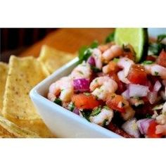 Salad shrimp, tomatoes, onion, cilantro, and lime juice combine for an tasty version of salsa for dipping your tortilla chips.