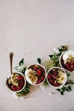 {Salted chocolate, raspberry and pistachio pots de crème.}