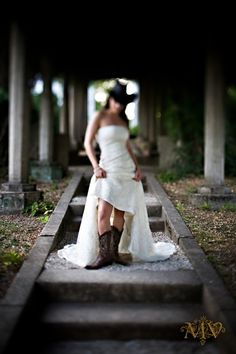 Cowgirl bride...Makes me wish I had done this photo. Had the boots on already!