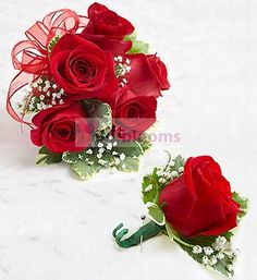 Make them stand out in a crowd with this classic corsage arrangement. For proms, weddings, or any celebration, our expert florists have hand-designed a stunning red rose wrist corsage that will make her the hit of the party. Pair it with a matching red rose boutonniere for an added touch of elegance
