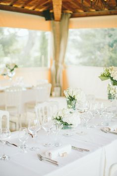 Image by  M&J Photography - A destination wedding in Provence with a lace gown and groom in blue suit. White on white colour scheme. Photography by M&J Photography.