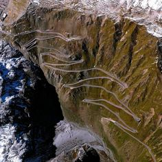 The Stelvio Pass is a road in northern Italy that is the highest paved roadway in the Eastern Alps, with an elevation of 9,045 ft above sea level. Only accessible in the summer months, the road and its 75 hairpin turns are sometimes scaled during the famous Giro d'Italia cycling race.